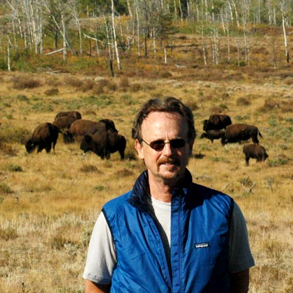 Kent Redford in front of a herd of buffalo